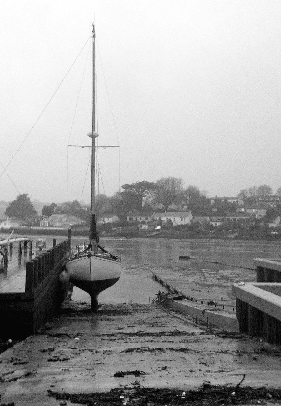 moored yacht,  low tide Penpol Creek
