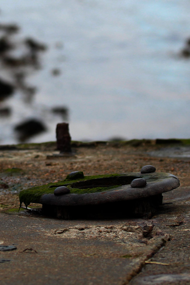 Deck porthole, concrete hulk, Purton